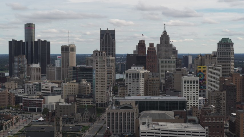 5.7K stock footage aerial video ascend and flyby the city's downtown skyline, Downtown Detroit, Michigan Aerial Stock Footage | DX0002_190_039