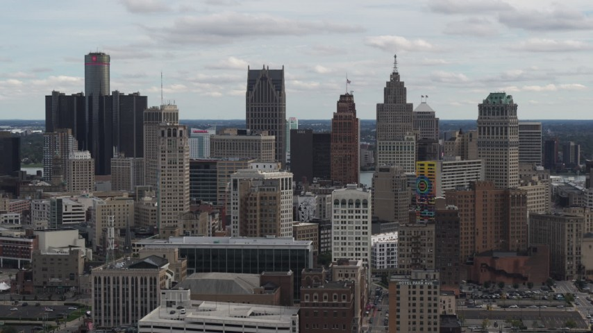 5.7K stock footage aerial video slowly descending past the city's downtown skyline, Downtown Detroit, Michigan Aerial Stock Footage | DX0002_190_040