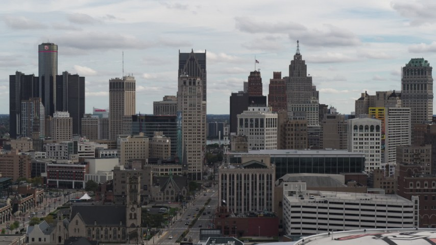 5.7K stock footage aerial video the city's downtown skyline seen from over the arena, Downtown Detroit, Michigan Aerial Stock Footage | DX0002_190_041