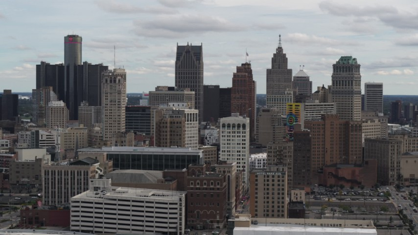 5.7K stock footage aerial video the city's downtown skyline seen while descending near arena, Downtown Detroit, Michigan Aerial Stock Footage | DX0002_190_042