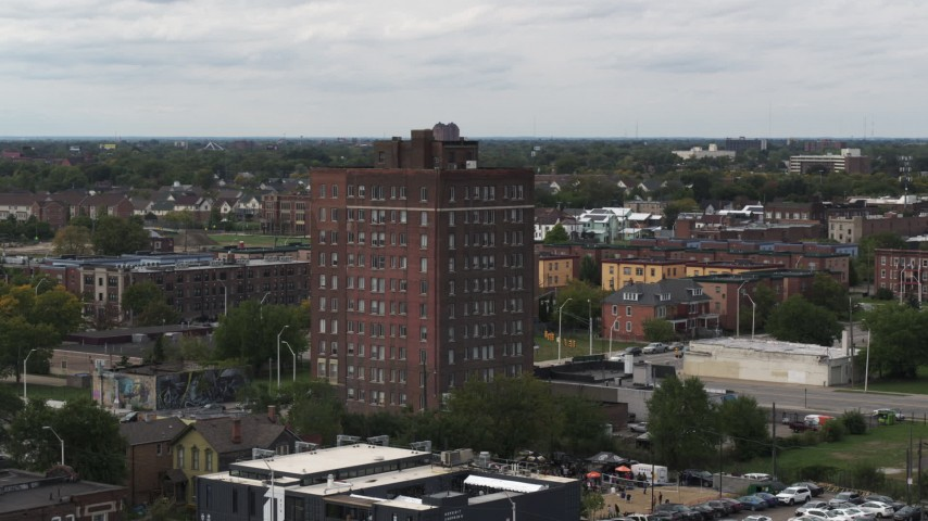 5.7K stock footage aerial video of orbiting a brick apartment building, Detroit, Michigan Aerial Stock Footage | DX0002_190_046