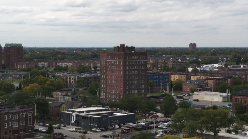 5.7K stock footage aerial video of circling a brick apartment building, Detroit, Michigan Aerial Stock Footage | DX0002_190_047