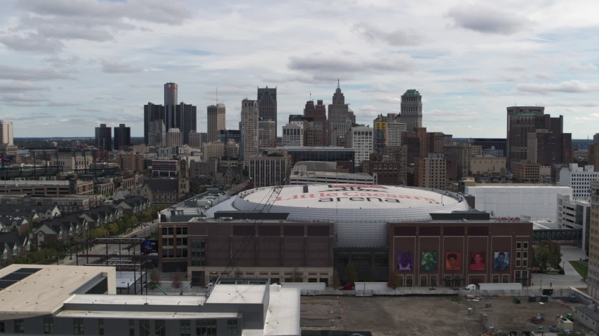 5.7K stock footage aerial video flyby the city's downtown skyline and arena, Downtown Detroit, Michigan Aerial Stock Footage | DX0002_191_001