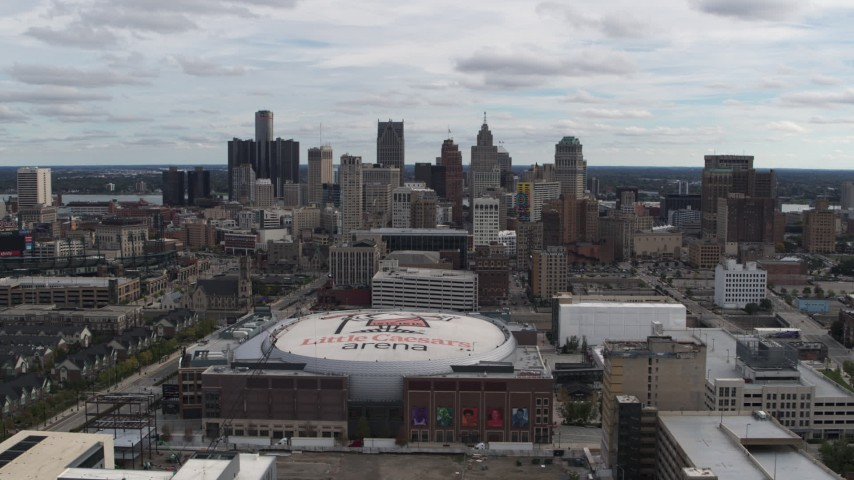 5.7K stock footage aerial video a wide view of the city's downtown skyline and arena, Downtown Detroit, Michigan Aerial Stock Footage | DX0002_191_002