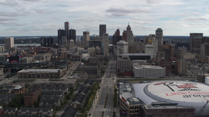 5.7K stock footage aerial video flying by the city's downtown skyline and arena, Downtown Detroit, Michigan Aerial Stock Footage | DX0002_191_003