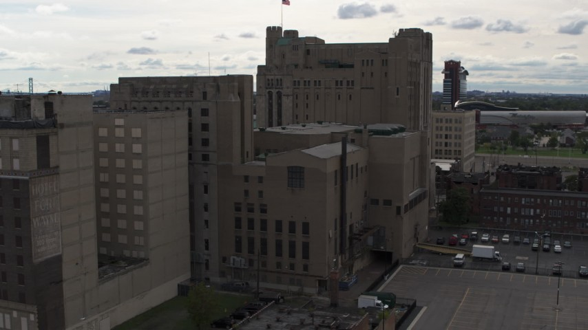 5.7K stock footage aerial video descend by the Detroit Masonic Temple building, Detroit, Michigan Aerial Stock Footage | DX0002_191_006