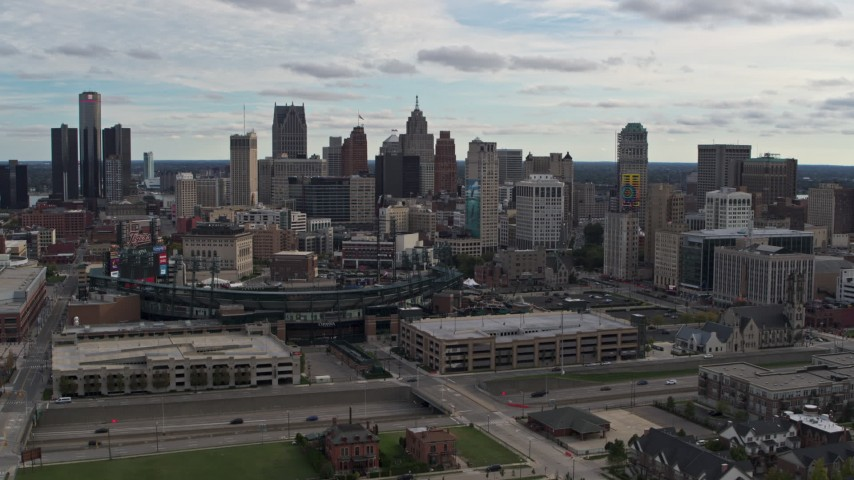 5.7K stock footage aerial video the skyline behind Comerica Park stadium, Downtown Detroit, Michigan Aerial Stock Footage | DX0002_191_011