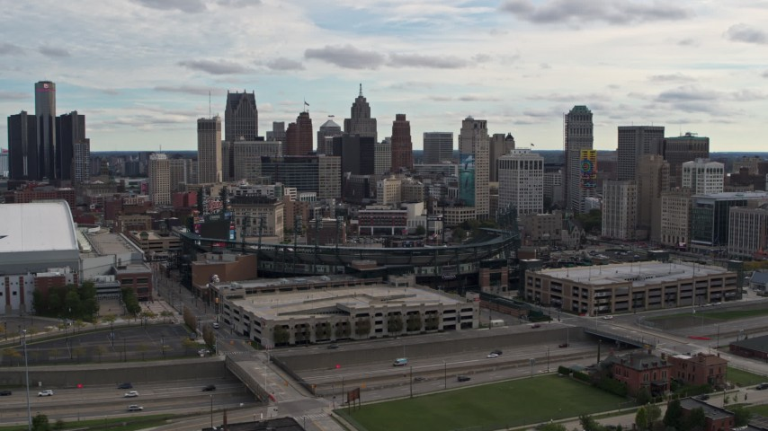 5.7K stock footage aerial video stationary view of Comerica Park baseball stadium and skyline, Downtown Detroit, Michigan Aerial Stock Footage | DX0002_191_012