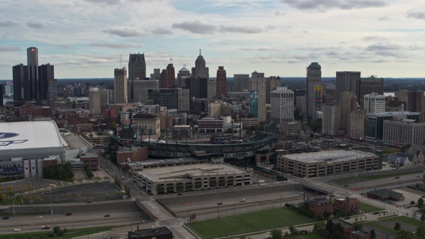 5.7K stock footage aerial video a reverse view of Comerica Park baseball stadium and skyline, Downtown Detroit, Michigan Aerial Stock Footage | DX0002_191_013