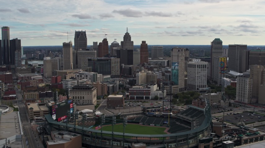 5.7K stock footage aerial video of approaching Comerica Park baseball stadium and skyline, Downtown Detroit, Michigan Aerial Stock Footage | DX0002_191_014