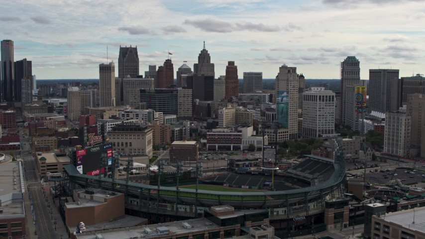 5.7K stock footage aerial video of descending by Comerica Park baseball stadium and skyline, Downtown Detroit, Michigan Aerial Stock Footage | DX0002_191_015