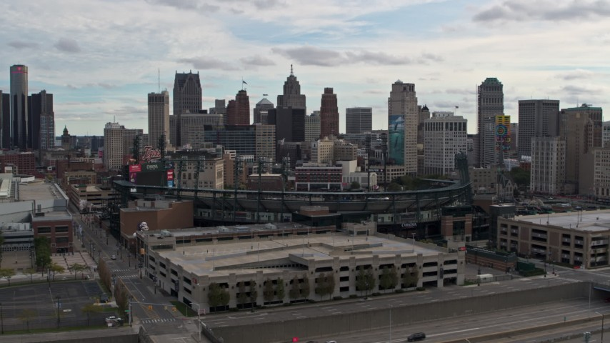 5.7K stock footage aerial video fly away from Comerica Park baseball stadium and skyline, Downtown Detroit, Michigan Aerial Stock Footage | DX0002_191_016