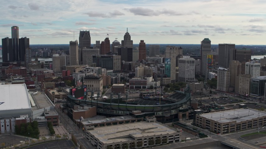 5.7K stock footage aerial video fly toward Comerica Park baseball stadium and skyline, Downtown Detroit, Michigan Aerial Stock Footage | DX0002_191_017