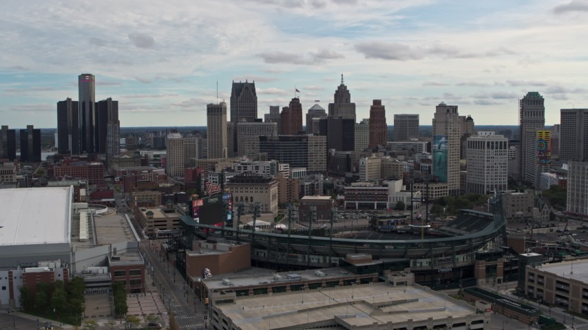 5.7K stock footage aerial video descend with view of baseball stadium and skyline, Downtown Detroit, Michigan Aerial Stock Footage | DX0002_191_018