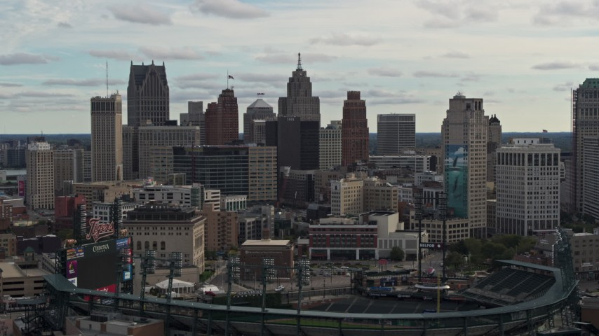 5.7K stock footage aerial video of the downtown skyline while flying by baseball stadium, Downtown Detroit, Michigan Aerial Stock Footage | DX0002_191_020