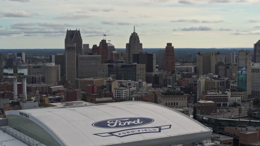 5.7K stock footage aerial video of the downtown skyline from Ford Field and Comerica Park, Downtown Detroit, Michigan Aerial Stock Footage | DX0002_191_023