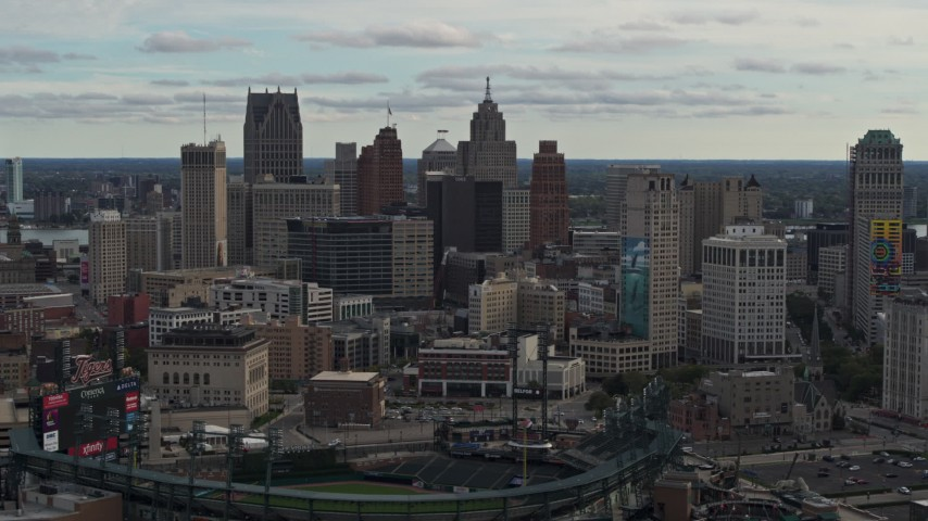 5.7K stock footage aerial video focus on the downtown skyline while flying by Comerica Park, Downtown Detroit, Michigan Aerial Stock Footage | DX0002_191_024