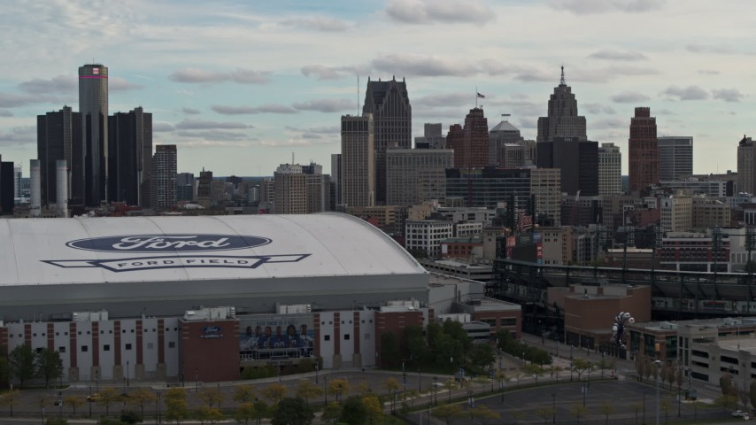 5.7K stock footage aerial video focus on downtown skyline, flyby Comerica Park and Ford Field, Downtown Detroit, Michigan Aerial Stock Footage | DX0002_191_027
