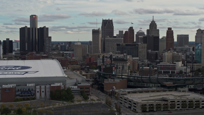 5.7K stock footage aerial video reverse view of skyline and Comerica Park, reveal Ford Field, Downtown Detroit, Michigan Aerial Stock Footage | DX0002_191_030