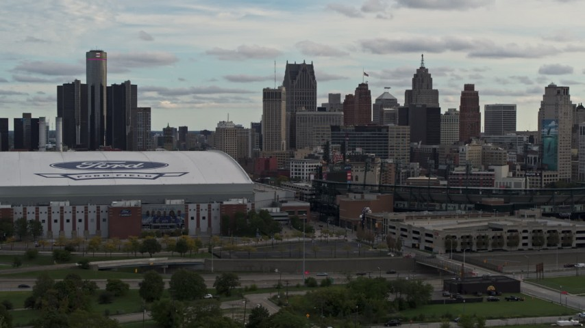 5.7K stock footage aerial video stationary view of skyline behind the stadiums, Downtown Detroit, Michigan Aerial Stock Footage | DX0002_191_031