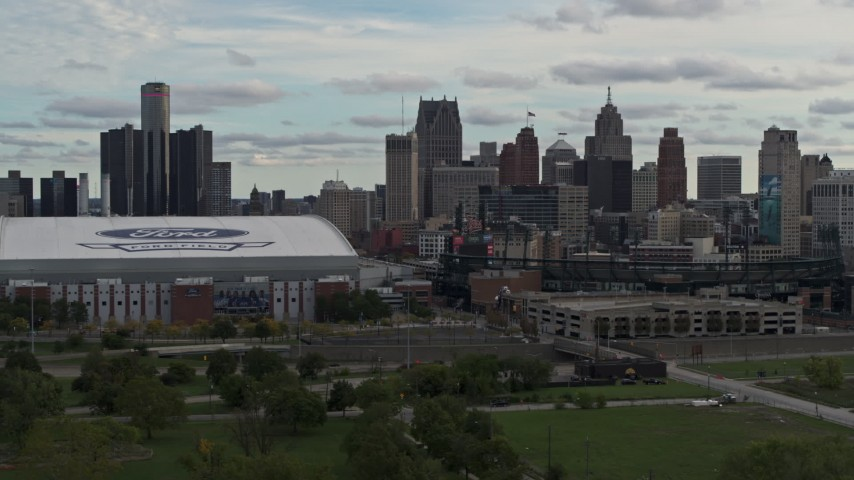5.7K stock footage aerial video flying away from stadiums with view of the skyline in Downtown Detroit, Michigan Aerial Stock Footage | DX0002_191_033