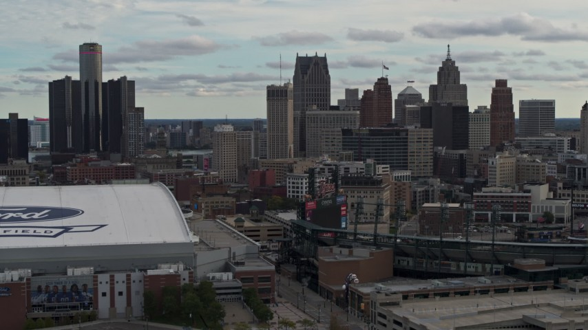 5.7K stock footage aerial video approach stadiums, ascend with view of the skyline in Downtown Detroit, Michigan Aerial Stock Footage | DX0002_191_034