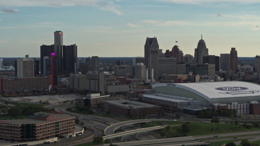 5.7K stock footage aerial video fly near football stadium and focus on the skyline at sunset in Downtown Detroit, Michigan Aerial Stock Footage | DX0002_191_038