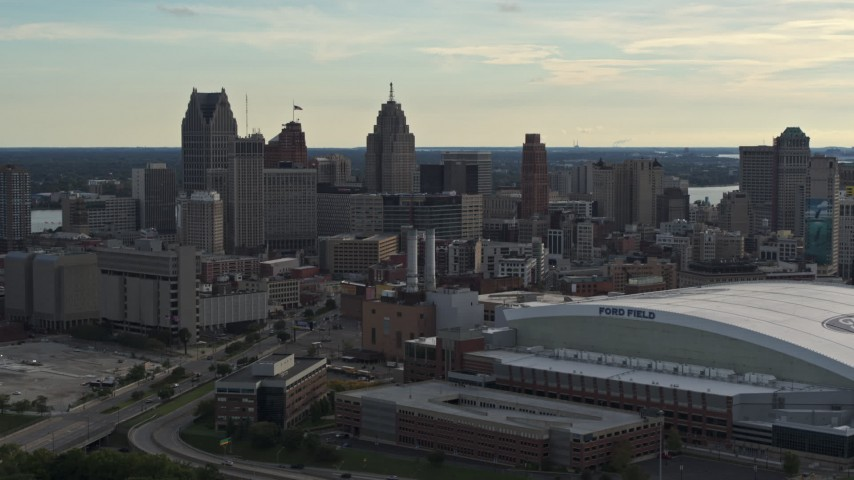 5.7K stock footage aerial video of a stationary view of the football stadium and the city skyline at sunset in Downtown Detroit, Michigan Aerial Stock Footage | DX0002_191_044
