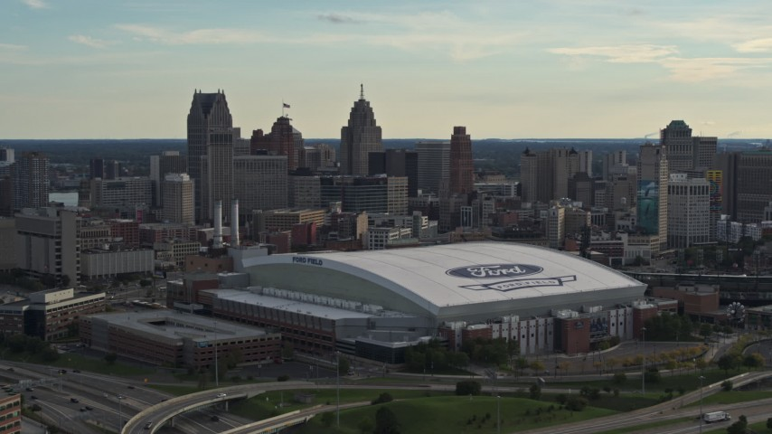 5.7K stock footage aerial video of Ford Field football stadium and the city skyline at sunset in Downtown Detroit, Michigan Aerial Stock Footage | DX0002_191_046
