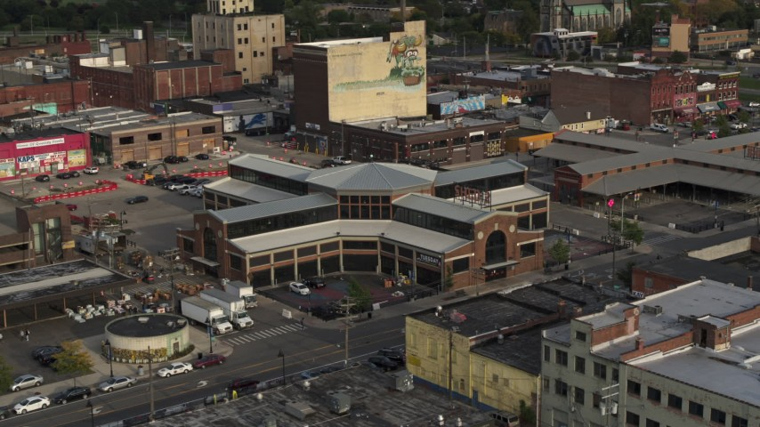 5.7K stock footage aerial video circling a farmers market at sunset in Detroit, Michigan Aerial Stock Footage | DX0002_191_048