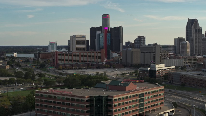 5.7K stock footage aerial video of tall skyscrapers and a hotel at sunset in Downtown Detroit, Michigan Aerial Stock Footage | DX0002_191_049