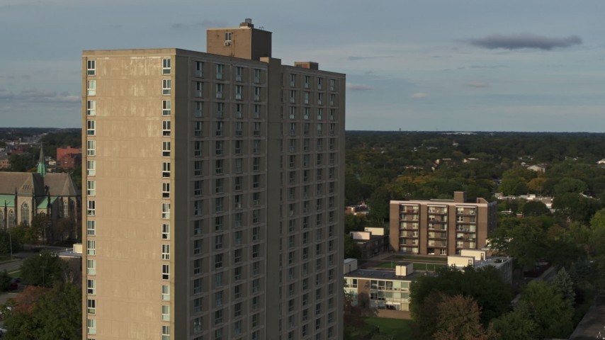 5.7K stock footage aerial video of the City Place Detroit apartment building at sunset, Detroit, Michigan Aerial Stock Footage | DX0002_192_001