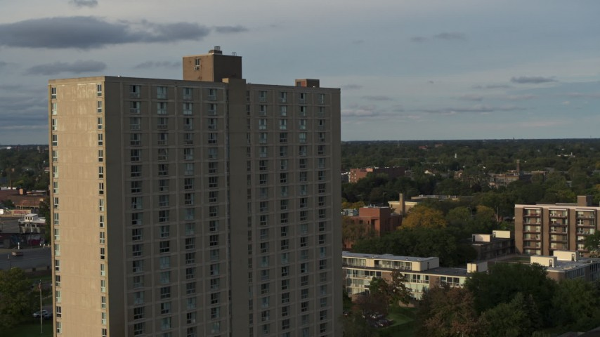 5.7K stock footage aerial video fly away from and orbit the City Place Detroit apartment building at sunset, Detroit, Michigan Aerial Stock Footage | DX0002_192_002