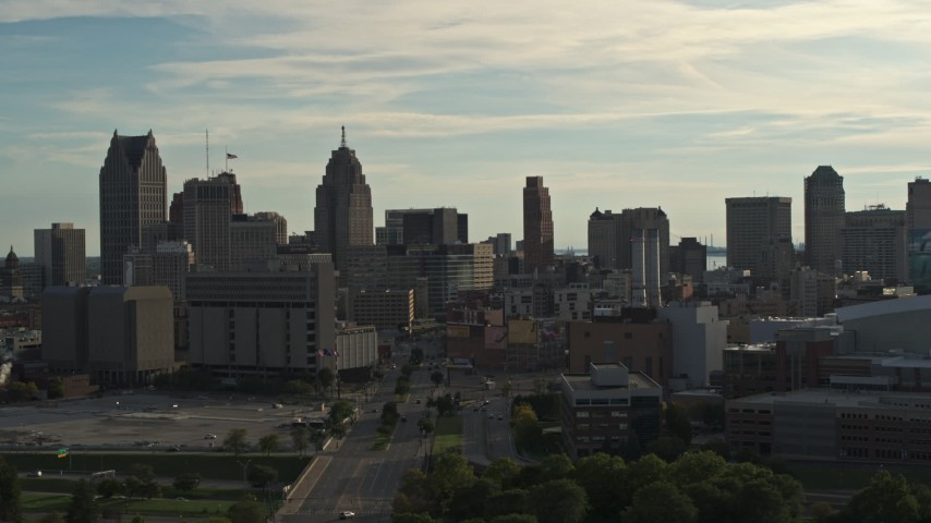 5.7K stock footage aerial video of flying by the city skyline at sunset in Downtown Detroit, Michigan Aerial Stock Footage | DX0002_192_004
