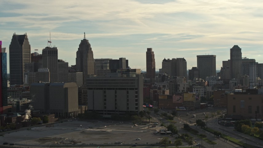 5.7K stock footage aerial video flyby the city skyline at sunset, descend with view of courthouse, Downtown Detroit, Michigan Aerial Stock Footage | DX0002_192_005