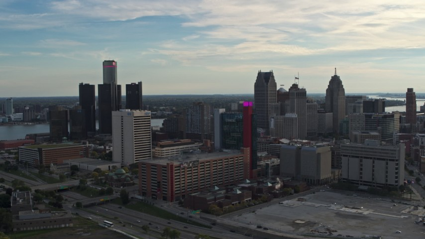 5.7K stock footage aerial video a view of tall skyscrapers behind a hotel at sunset, Downtown Detroit, Michigan Aerial Stock Footage | DX0002_192_006