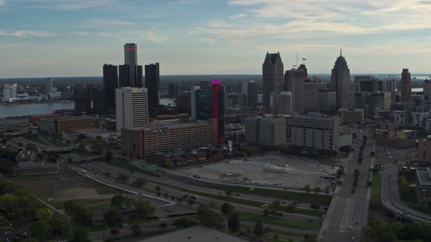 5.7K stock footage aerial video a reverse view of tall skyscrapers behind a hotel at sunset, Downtown Detroit, Michigan Aerial Stock Footage | DX0002_192_007