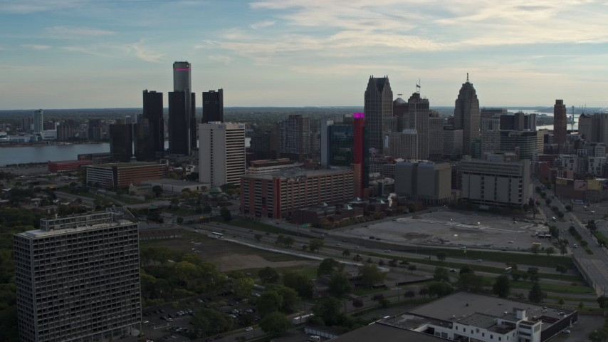 5.7K stock footage aerial video slowly flying by tall skyscrapers behind a hotel at sunset, Downtown Detroit, Michigan Aerial Stock Footage | DX0002_192_008