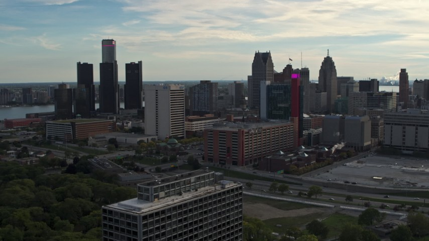 5.7K stock footage aerial video slowly passing tall skyscrapers behind a hotel at sunset, Downtown Detroit, Michigan Aerial Stock Footage | DX0002_192_009