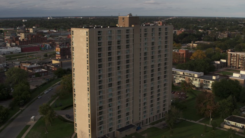 5.7K stock footage aerial video an orbit of the City Place Detroit apartment building at sunset, Detroit, Michigan Aerial Stock Footage | DX0002_192_011