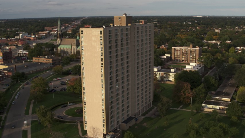 5.7K stock footage aerial video orbit side of the City Place Detroit apartment building at sunset, Detroit, Michigan Aerial Stock Footage | DX0002_192_013
