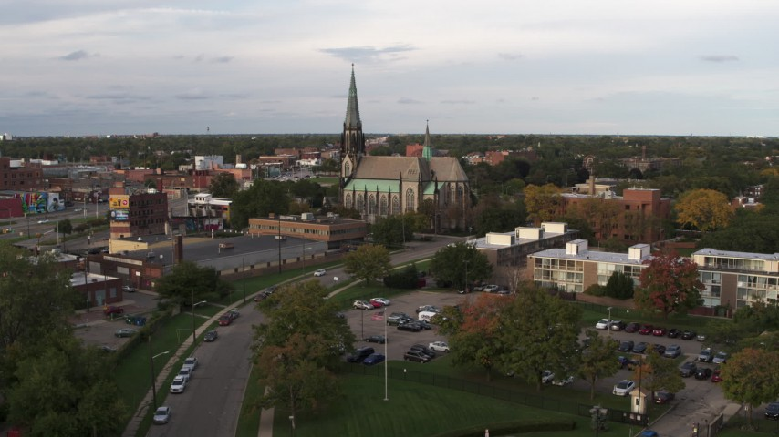 5.7K stock footage aerial video of flying away from and by a church at sunset, Detroit, Michigan Aerial Stock Footage | DX0002_192_018
