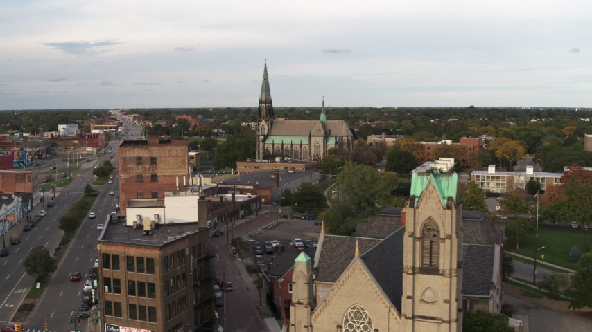 5.7K stock footage aerial video of a view of a church at sunset, Detroit, Michigan Aerial Stock Footage | DX0002_192_019
