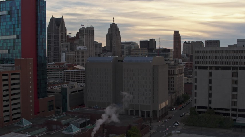 5.7K stock footage aerial video of orbiting the Wayne County Jail Division 1 building at sunset, Downtown Detroit, Michigan Aerial Stock Footage | DX0002_192_021
