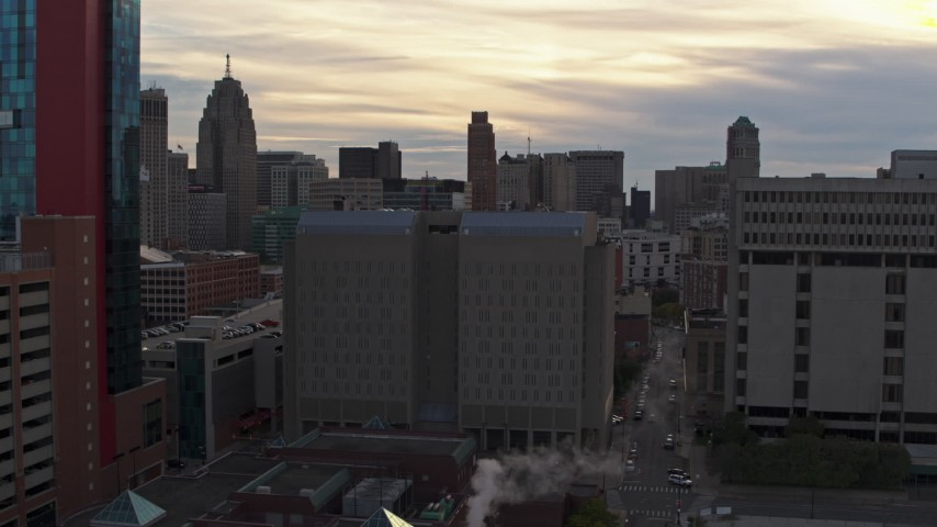 5.7K stock footage aerial video of a stationary view of the Wayne County Jail Division 1 building at sunset, Downtown Detroit, Michigan Aerial Stock Footage | DX0002_192_022
