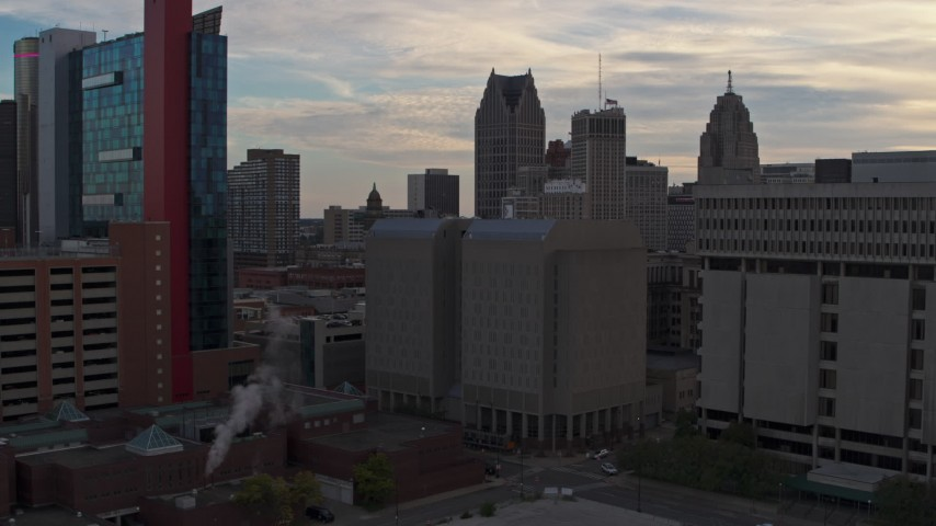 5.7K stock footage aerial video of an orbit of the Wayne County Jail Division 1 building at sunset, Downtown Detroit, Michigan Aerial Stock Footage | DX0002_192_023