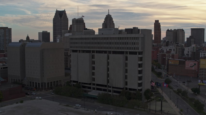 5.7K stock footage aerial video of orbiting Frank Murphy Hall of Justice courthouse at sunset, Downtown Detroit, Michigan Aerial Stock Footage | DX0002_192_025