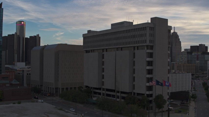 5.7K stock footage aerial video descend and fly away from Frank Murphy Hall of Justice at sunset, Downtown Detroit, Michigan Aerial Stock Footage | DX0002_192_027