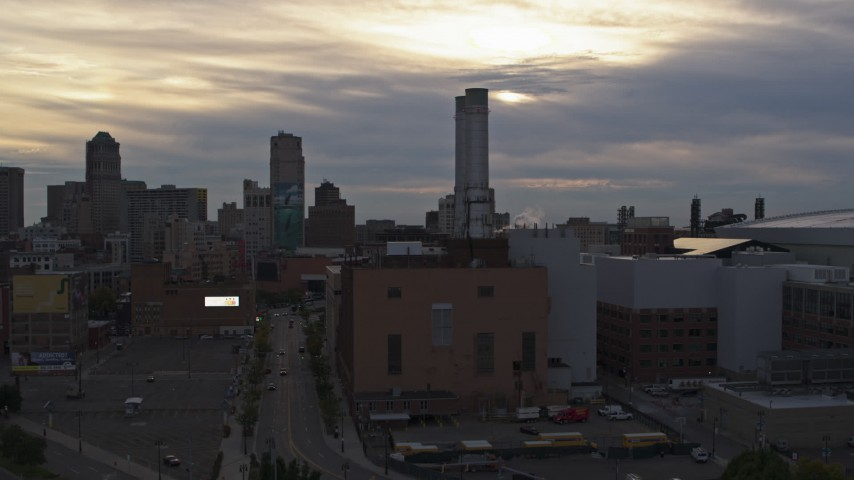 5.7K stock footage aerial of a reverse view of the Detroit Thermal plant at sunset, Downtown Detroit, Michigan Aerial Stock Footage | DX0002_192_030