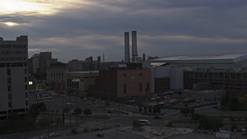 5.7K stock footage aerial of approaching the Detroit Thermal plant at sunset, Downtown Detroit, Michigan Aerial Stock Footage | DX0002_192_031